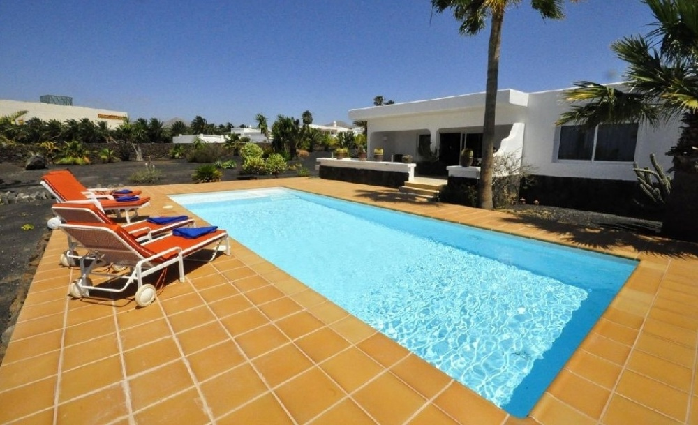 Luxury 3 Bedroom Villa with Private Heated Pool and Sea View - Puerto Calero - lanzaroteproperty.com